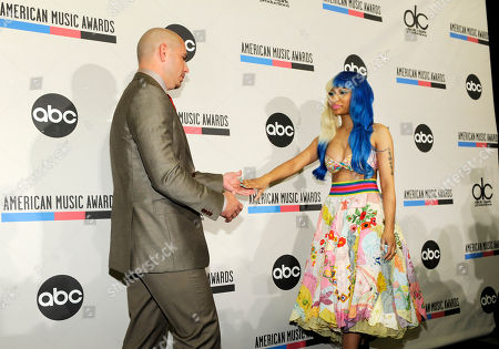 Nicky Minaj, Pitbull Pitbull, left, and Nicky Minaj join hands before posing for photos following the announcement of nominations for the 2011 American Music Awards, in Los Angeles. The awards will be held in Los Angeles on November 20