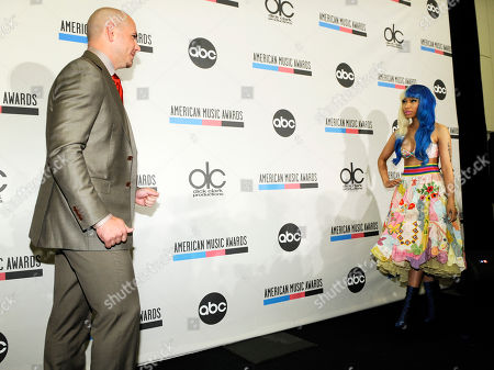 Nicky Minaj, Pitbull Pitbull, left, and Nicky Minaj walk toward each other for photos after they announced nominations for the 2011 American Music Awards, in Los Angeles. The awards will be held in Los Angeles on November 20