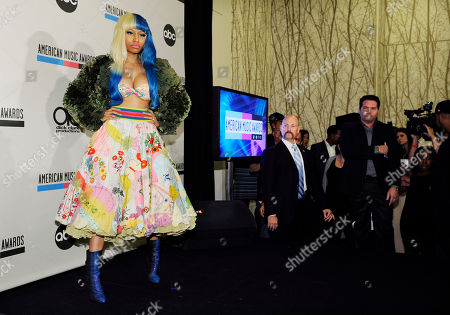 Nicky Minaj Nicky Minaj poses after announcing nominations for the 2011 American Music Awards, in Los Angeles. The awards will be held in Los Angeles on November 20