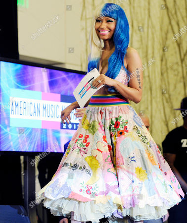 Nicky Minaj Nicky Minaj arrives onstage to announce nominations for the 2011 American Music Awards, in Los Angeles. The awards will be held in Los Angeles on November 20