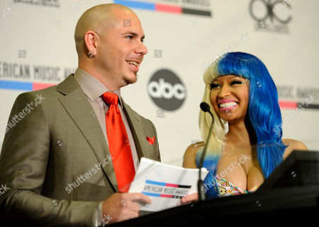 Nicky Minaj, Pitbull Pitbull, left, and Nicky Minaj announce nominations for the 2011 American Music Awards, in Los Angeles. The awards will be held in Los Angeles on November 20