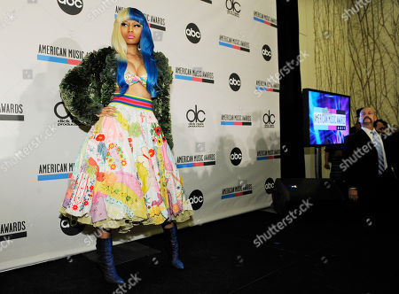 Nicky Minaj Singer Nicky Minaj poses for photographers after announcing nominations for the 2011 American Music Awards, in Los Angeles. The awards will be held in Los Angeles on November 20