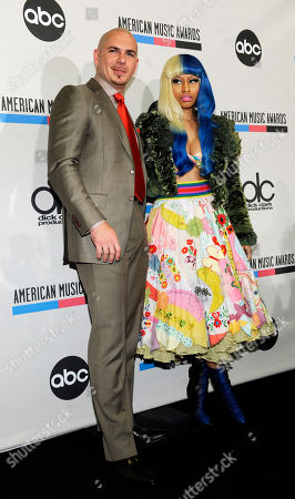 Nicky Minaj, Pitbull Pitbull, left, and Nicky Minaj pose after announcing nominations for the 2011 American Music Awards, in Los Angeles. The awards will be held in Los Angeles on November 20