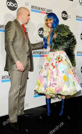 Nicky Minaj, Pitbull Pitbull, left, and Nicky Minaj pose together after announcing nominations for the 2011 American Music Awards, in Los Angeles. The awards will be held in Los Angeles on November 20