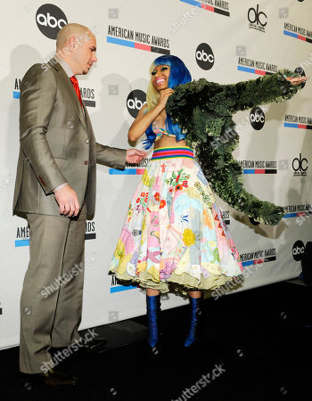 Stock Picture of Nicky Minaj, Pitbull Pitbull, left, looks on as Nicky Minaj, right, puts on a jacket for photos after they announced nominations for the 2011 American Music Awards, in Los Angeles. The awards will be held in Los Angeles on November 20