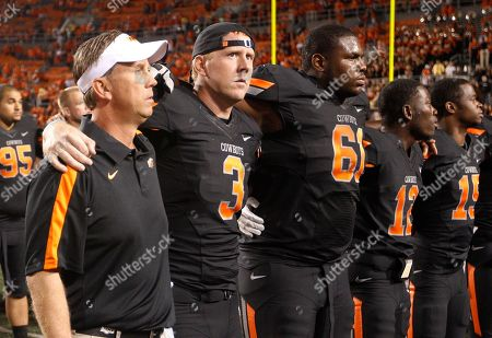 Brandon Weeden, Todd Monken, Michael Bowie Oklahoma State quarterback Brandon Weeden, second from left, joins in with offensive coordinator Todd Monken, left, and teammate Michael Bowie, (61), as the team sings the alma mater with their fans following an NCAA college football game against Arizona in Stillwater, Okla., . Oklahoma State won 37-14