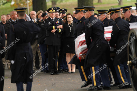Stock Image of Robbie L. Asher, Jane Horton Brig. Gen. Robbie L. Asher, director, Joint Staffs Oklahoma National Guard, center, escorts Jane Horton, widow of U.S. Army Spc. Christopher D. Horton, 26, of Collinsville, Okla., who died while serving in Afghanistan, as the casket arrives for burial services at Arlington National Cemetery in Arlington, Va