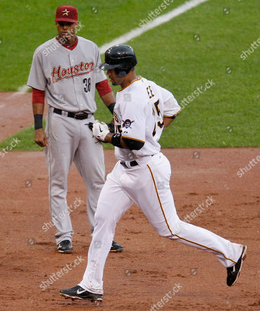 Derrek Lee, Jimmy Paredes Pittsburgh Pirates' Derrek Lee, right, rounds third past Houston Astros third baseman Jimmy Paredes on a solo home run off Astros pitcher Wilson Lopez during the eighth inning of a baseball game in Pittsburgh, . The Pirates won 3-1