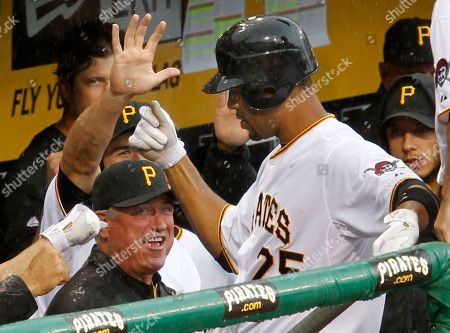 Derrek Lee, Clint Hurdle Pittsburgh Pirates' Derrek Lee, right, returns to the dugout to celebrate with manager Clint Hurdle, bottom left, and teammates after hitting a solo home run off Houston Astros pitcher Wilson Lopez in the eighth inning of a baseball game in Pittsburgh, . The Pirates won 3-1