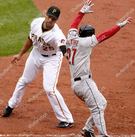 Derrek Lee, Jose Altuve Houston Astros' Jose Altuve, right, is tagged out by Pittsburgh Pirates first baseman Derrek Lee after laying down a sacrifice bunt advancing Astros' Jordan Schafer to second during the sixth inning of a baseball game in Pittsburgh, . The Pirates won 3-1