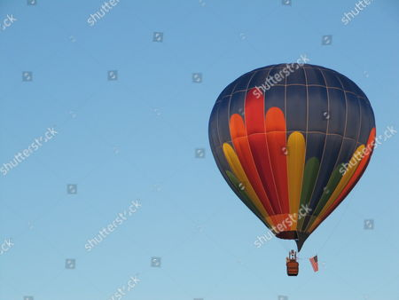 Stock Image of Several hot air balloons lift off from Ann Morrison Park in Boise, Idaho on as part of the Spirit of Boise Balloon Classic event