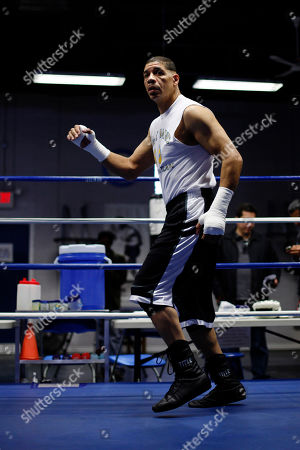Dewey Bozella In this photo made, boxer Dewey Bozella works out in Philadelphia. Bozella spent 26 years in prison for a crime he did not commit. He boxed in prison and dreamed of just one bout if he ever got out. The 52-year-old Bozella fights on the undercard of Hopkins-Dawson on Saturday, Oct. 15 in Los Angeles