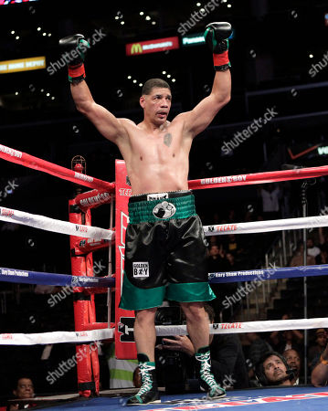 Dewey Bozella Dewey Bozella raises his arms in the fourth round of a boxing match with Larry Hopkins in Los Angeles, . Bozella won by unanimous decision after the fourth round