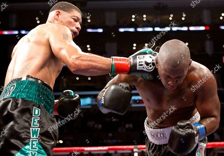 Stock Image of Dewey Bozella Dewey Bozella, left, lands a punch to Larry Hopkins during the fourth round of their boxing match at the Staple Center, in Los Angeles. Bozella, 52, spent 26 years in prison for a crime he did not commit. Bozella won by unanimous decision after the fourth round