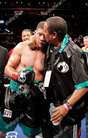 Dewey Bozella Dewey Bozella, gets a hug from a trainer after defeating Larry Hopkins in a boxing match in Los Angeles, . Bozella won by unanimous decision after the fourth round. Bozella spent 26 years in prison for a murder he didn't commit