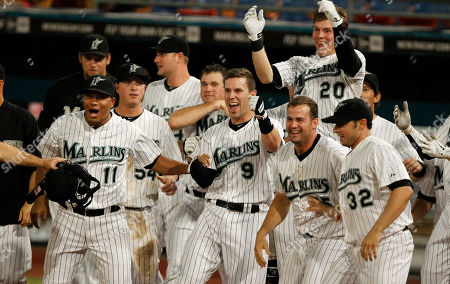 Jose Lopez, Brett Hayes, Gaby Sanchez, Clay Hensley, Logan Morrison Florida Marlins' Jose Lopez (11), Brett Hayes (9) Gaby Sanchez, second from right, Clay Hensley (32) and Logan Morrison (20) celebrate after the Marlins defeated the Atlanta Braves 6-5 on a walk off home run by Omar Infante, not shown, during a baseball game in Miami
