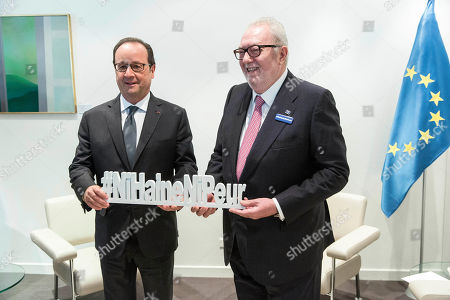 """French President Francois Hollande, left, and President of the Parliamentary Assembly of the Council of Europe Pedro Agramunt hold a sign reading """"No hate, No fear"""" during their meeting in Strasbourg, eastern France. Hollandewill later speak at the Council of Europe"""