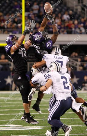 Matthew Tucker, Tank Carder,Spencer Hadley, Hadley, Michael Alisa TCU's Matthew Tucker (29) and Tank Carder (43) jump for the onside kick against BYU's Spencer Hadley (2), Preston Hadley (7) and Michael Alisa during the fourth quarter of an NCAA college football game, in Arlington, Texas, . TCU won 38-28