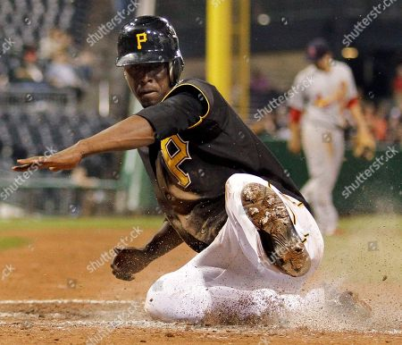 Pedro Ciriaco Pittsburgh Pirates' Pedro Ciriaco slides across the plate after tagging at third on a sacrifice fly by Derrek Lee in the fifth inning of a baseball game in Pittsburgh on . The Cardinals appealed at third and Ciriaco was ruled out by umpire Sam Holbrook for leaving before the catch. Pirates manager Clint Hurdle was ejected from the game arguing the call. The Cardinals won 6-4