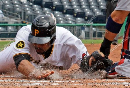 Yadier Molina, Derrek Lee Pittsburgh Pirates' Derrek Lee, left, is tagged out at home plate by St. Louis Cardinals catcher Yadier Molina while attempting to score on an infield grounder by Pedro Alvarez during the second inning of a baseball game in Pittsburgh, . The Cardinals won 3-2