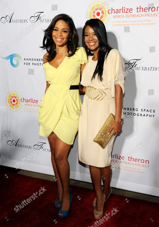 """Sanaa Lathan, Gabrielle Union Actresses Sanaa Lathan, left, and Gabrielle Union pose together at a cocktail party featuring the world premiere of the celebrity photo series, """"REACH: 24 portraits by Randall Slavin to benefit the Charlize Theron Africa Outreach Project,"""", at The Annenberg Space for Photography in Los Angeles. The CTAOP is committed to reducing the prevalence of HIV/AIDS and sexual violence among African youth"""