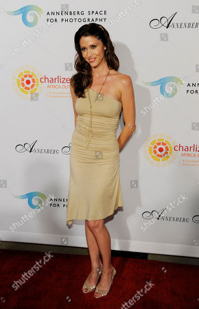 """Shannon Elizabeth Actress Shannon Elizabeth poses at a cocktail party featuring the world premiere of the celebrity photo series, """"REACH: 24 portraits by Randall Slavin to benefit the Charlize Theron Africa Outreach Project,"""", at The Annenberg Space for Photography in Los Angeles. The CTAOP is committed to reducing the prevalence of HIV/AIDS and sexual violence among African youth"""
