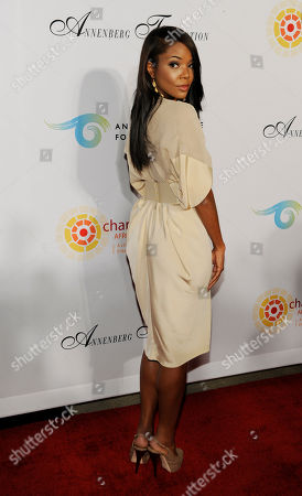 """Gabrielle Union Actress Gabrielle Union poses at a cocktail party featuring the world premiere of the celebrity photo series, """"REACH: 24 portraits by Randall Slavin to benefit the Charlize Theron Africa Outreach Project,"""", at The Annenberg Space for Photography in Los Angeles. The CTAOP is committed to reducing the prevalence of HIV/AIDS and sexual violence among African youth"""