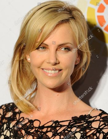 """Charlize Theron Actress Charlize Theron poses at a cocktail party featuring the world premiere of the celebrity photo series, """"REACH: 24 portraits by Randall Slavin to benefit the Charlize Theron Africa Outreach Project,"""", at The Annenberg Space for Photography in Los Angeles. The CTAOP is committed to reducing the prevalence of HIV/AIDS and sexual violence among African youth"""