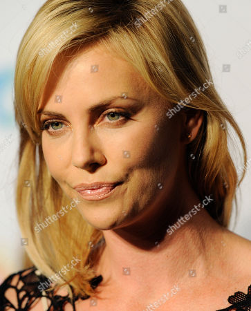 """Charlize Theron Actress Charlize Theron is pictured at a cocktail party featuring the world premiere of the celebrity photo series, """"REACH: 24 portraits by Randall Slavin to benefit the Charlize Theron Africa Outreach Project,"""", at The Annenberg Space for Photography in Los Angeles. The CTAOP is committed to reducing the prevalence of HIV/AIDS and sexual violence among African youth"""