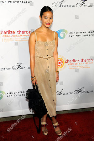 """Jamie Chung Actress Jamie Chung poses at a cocktail party featuring the world premiere of the celebrity photo series, """"REACH: 24 portraits by Randall Slavin to benefit the Charlize Theron Africa Outreach Project,"""", at The Annenberg Space for Photography in Los Angeles. The CTAOP is committed to reducing the prevalence of HIV/AIDS and sexual violence among African youth"""