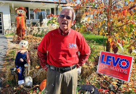 John Levo John Levo speaks outside his home, in Hillsboro, Ohio. Levo, an independent, is running against Republican candidate Drew Hastings for mayor of the Southern Ohio town. Hastings is a nationally known comedian