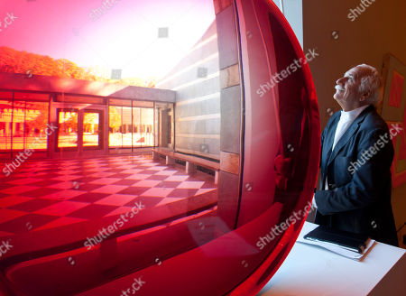 Moshe Safdie Architect Moshe Safdie looks out of a window next to a large red untitled magnifying disk sculpture by artist Fred Eversley at Crystal Bridges Museum of American Art in Bentonville, Ark., . Safdie designed the museum scheduled to open Nov. 11