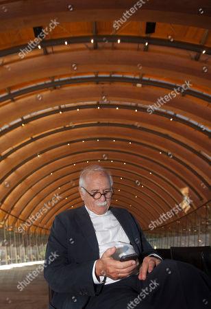 Moshe Safdie Architect Moshe Safdie shecks his phone at Crystal Bridges Museum of American Art in Bentonville, Ark