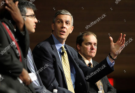 "Arne Duncan, Eric Gordon U.S. Secretary of Education Arne Duncan, second from right, participates in a panel discussion on community partnerships in education at East Technical High School, in Cleveland. The discussion aims to encourage community-based organizations to become more invested in the educational success of students. Duncan's visit to Cleveland is part of ""Education and the Economy, "" a three-day back to school bus tour around the Great Lakes. Cleveland schools CEO Eric Gordon is seated on the right"