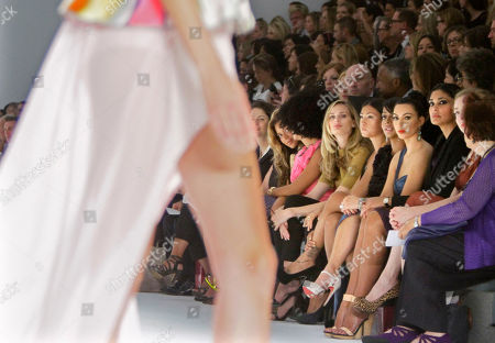 TV personalities, La La Anthony, third from right, Kim Kardashian, second from right, and designer Rachel Roy, right look on during the presentation of Vera Wang's Spring 2012 collection on in New York