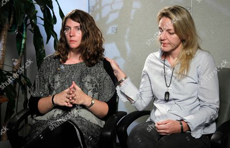 Kerry Cahill, Keely Vanacker Kerry Cahill, right, daughter of Michael Cahill, one of the 13 people killed in a shooting rampage at Fort Hood, Texas, consoles her sister Keely Vanacker during an interview with the Associated Press in Washington