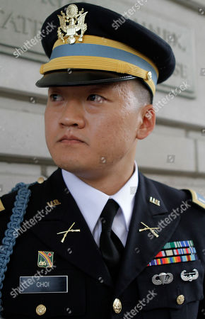 """Dan Choi Former Army Lt. Dan Choi, an openly gay Iraq war veteran who protested the military's """"don't ask, don't tell"""" policy by handcuffing himself to a White House fence, listens as his lawyer speaks to the media after the start of his trial in Washington, on . Choi is charged with failing to obey a police officer's order to leave the grounds. He and 12 others chained themselves to the White House fence in November 2010 during a protest"""