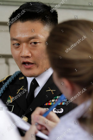 """Stock Photo of Dan Choi Former Army Lt. Dan Choi, an openly gay Iraq war veteran who protested the military's """"don't ask, don't tell"""" policy by handcuffing himself to a White House fence, speaks with a reporter after the start of his trial in Washington, on . Choi is charged with failing to obey a police officer's order to leave the grounds. He and 12 others chained themselves to the White House fence in November 2010 during a protest"""