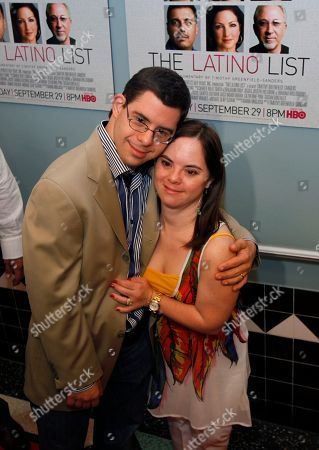 """Monica Martinez, David Martinez David and Monica Martinez, who were featured in the HBO documentary """"Monica & David,"""" pose on the red-carpet as they attend the screening of the documentary """"The Latino List,"""" in Miami Beach, Fla"""