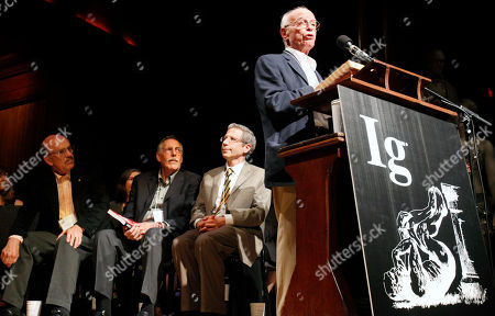Stock Photo of John Senders, Lou Ignarro, Peter Diamond, Eric Maskin John Senders of the University of Toronto gives his acceptance speech after receiving the Ig Nobel prize for Public Safety beside Nobel Laureates, from left, Lou Ignarro (Medicine, 1998), Peter Diamond (Economics, 2010) and Eric Maskin (Economics, 2007) during the 21st annual Ig Nobel Awards ceremony at Harvard University in Cambridge, Mass., . Senders won for his experiments in which a driver on a major highway repeatedly has a visor flapped down over his face