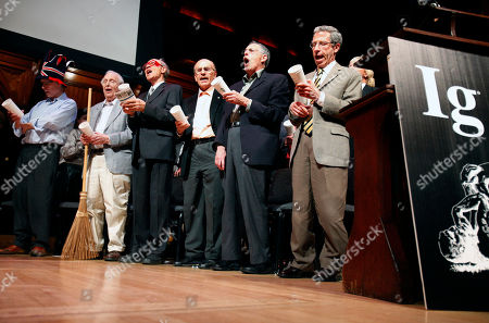 Stock Image of Rich Roberts, Roy Glauber, Dudley Herschbach, Lou Ignaro, Peter Diamond, Eric Maskin Nobel Laureates, from left, Rich Roberts (Medicine, 2005), Roy Glauber (Physics, 2005), Dudley Herschbach (Chemistry, 1986), Lou Ignaro (Medicine, 1998), Peter Diamond (Economics, 2010) and Eric Maskin (Economics, 2007) perform in a sing-along during the 21st annual Ig Nobel Awards ceremony at Harvard University in Cambridge, Mass
