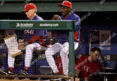 Jackie Moore, Ron Washington Texas Rangers manager Ron Washington, center, and bench coach Jackie Moore, left, look on at play in the eighth inning of a baseball game against the Cleveland Indians, in Arlington, Texas. The Rangers won 7-4