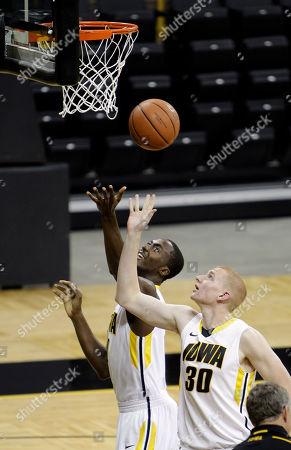 Aaron White, Gabe Olaseni Iowa forward Aaron White (30) shoots over teammate center Gabe Olaseni, left, during Iowa's annual NCAA college basketball media day, in Iowa City, Iowa
