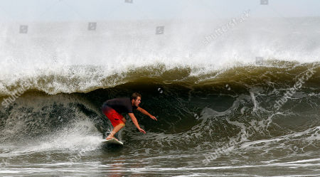 Ray Smith Ray Smith surfs a wave after Hurricane Irene, on Long Beach Island in Long Beach Township, N.J. From North Carolina to New Jersey, Hurricane Irene, later downgraded to a tropical storm, appeared to have fallen short of the doomsday predictions, but more than 4.5 million homes and businesses along the East Coast reportedly lost power, and at least 11 deaths were blamed on the storm
