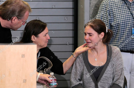 Amanda Knox Amanda Knox, right, is comforted by her parents Curt Knox, left, and Edda Mellas as she sits during a news conference shortly after her arrival at Seattle-Tacoma International Airport, in Seattle. It's been four years since the University of Washington student left for the study abroad program in Perugia and landed in prison. The group Friends of Amanda Knox and others have been awaiting her return since an Italian appeals court on Monday overturned her conviction of sexually assaulting and killing her British roommate, Meredith Kercher