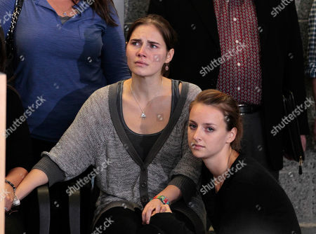 Stock Photo of Amanda Knox, Deanna Knox Amanda Knox, left, is comforted by her sister, Deanna Knox, during a news conference shortly after her arrival at Seattle-Tacoma International Airport, in Seattle. It's been four years since the University of Washington student left for the study abroad program in Perugia and landed in prison. The group Friends of Amanda Knox and others have been awaiting her return since an Italian appeals court on Monday overturned her conviction of sexually assaulting and killing her British roommate, Meredith Kercher