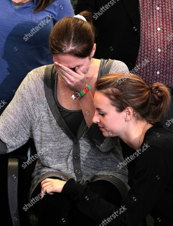 Stock Image of Amanda Knox Amanda Knox, left, is comforted by her sister, Deanna Knox, during a news conference shortly after her arrival at Seattle-Tacoma International Airport, in Seattle. It's been four years since the University of Washington student left for the study abroad program in Perugia and landed in prison. The group Friends of Amanda Knox and others have been awaiting her return since an Italian appeals court on Monday overturned her conviction of sexually assaulting and killing her British roommate, Meredith Kercher