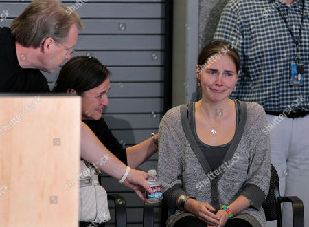 Amanda Knox Amanda Knox, right, is comforted by her parents Curt Knox, left, and Edda Mellas as during a news conference shortly after her arrival at Seattle-Tacoma International Airport, in Seattle. Knox was freed Monday after an Italian appeals court threw out her murder conviction for the death of her British roommate, Meredith Kercher