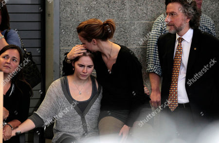 Amanda Knox Amanda Knox, left, is comforted by her sister, Deanna Knox, during a news conference shortly after her arrival at Seattle-Tacoma International Airport, in Seattle. It's been four years since the University of Washington student left for the study abroad program in Perugia and landed in prison. The group Friends of Amanda Knox and others have been awaiting her return since an Italian appeals court on Monday overturned her conviction of sexually assaulting and killing her British roommate, Meredith Kercher