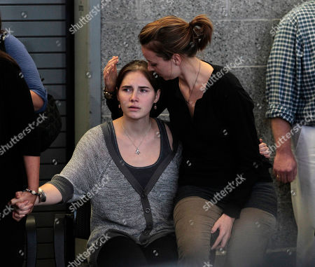 Amanda Knox, Deanna Knox Amanda Knox, left, is comforted by her sister, Deanna Knox, during a news conference shortly after her arrival at Seattle-Tacoma International Airport, in Seattle. It's been four years since the University of Washington student left for the study abroad program in Perugia and landed in prison. The group Friends of Amanda Knox and others have been awaiting her return since an Italian appeals court on Monday overturned her conviction of sexually assaulting and killing her British roommate, Meredith Kercher
